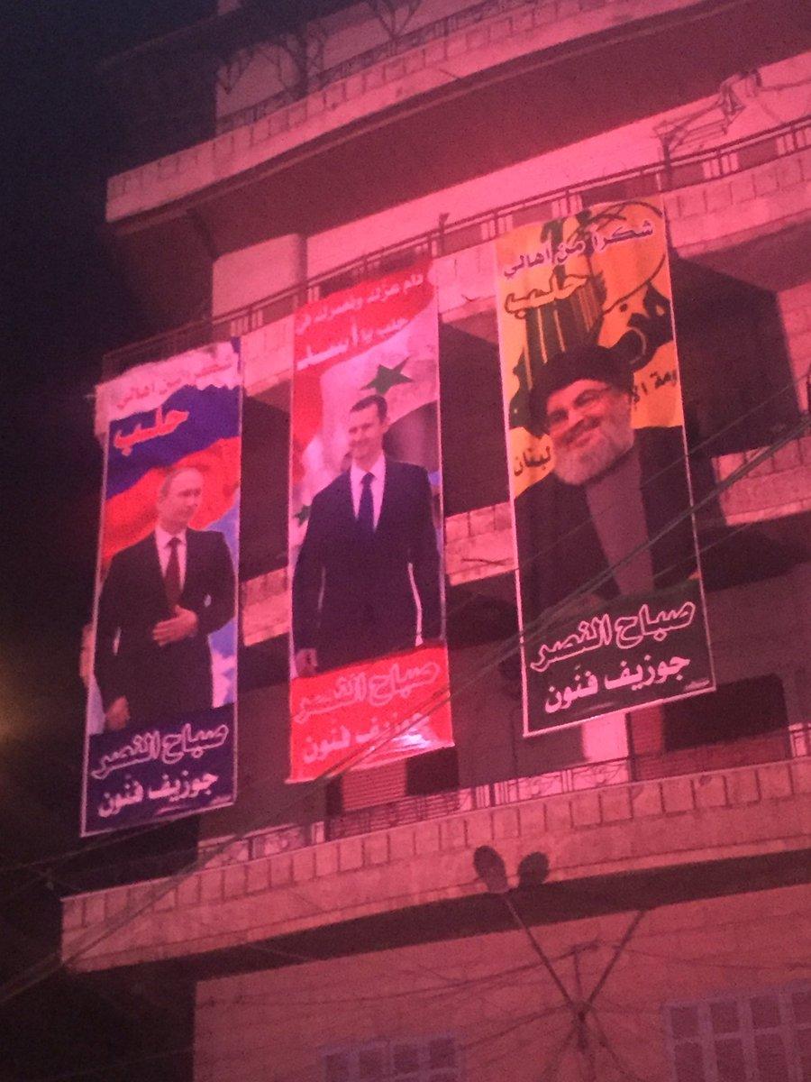 """صورة لماذا أمر """"لواء القدس"""" عناصره بإزالة صور بوتين؟"""