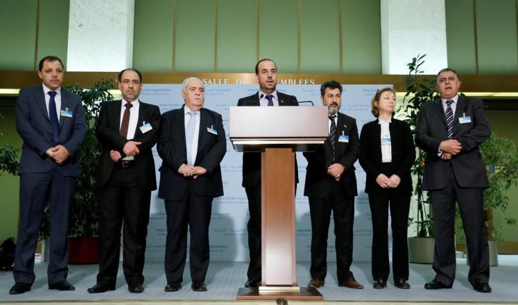 صورة وجها لوجه..مفاوضات بين وفدي الأسد والمعارضة