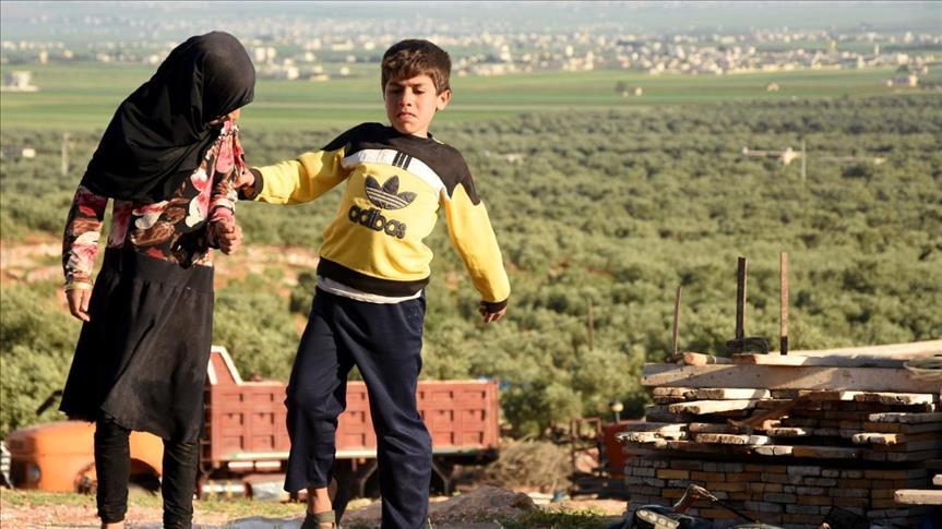 """صورة خالد..مثال للطفل """"الغريب"""" في وطنه"""