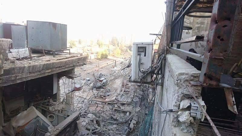 صورة معارك بين فتح الشام وتنظيم الدولة في مخيم اليرموك