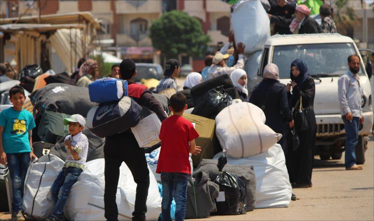 """صورة مهجرو حي الوعر يرفضون """"معيشة الذل"""""""