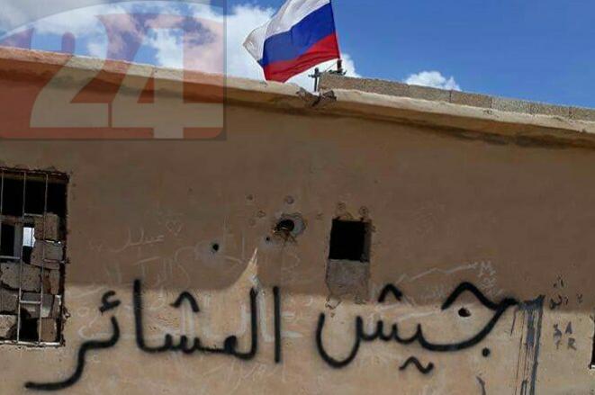 صورة الأسد يسقط رايته بريف السويداء ويتبنى العلم الروسي