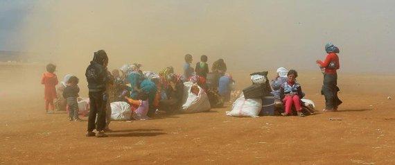 صورة تدخل أممي لأجل السوريين العالقين بين الحدود العربية