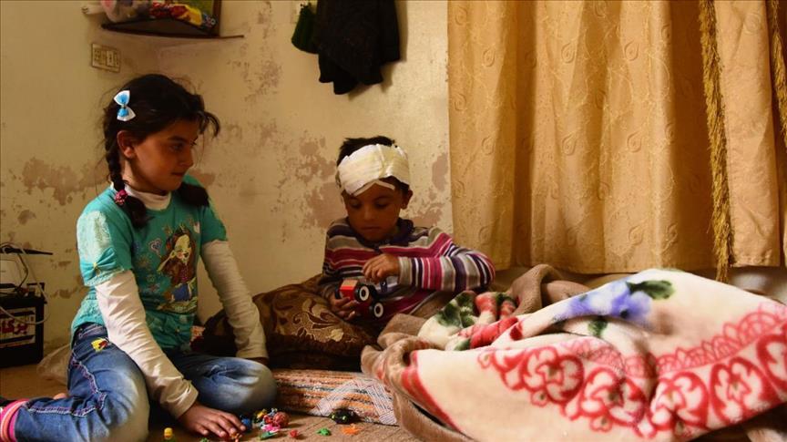 """صورة """"محيو"""" وندى..الأسد أباد عائلتهما وتركهما جريحا الجسد والروح"""