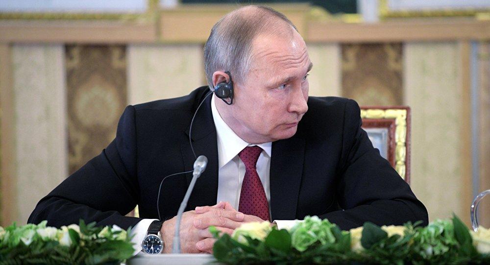 صورة بوتين: نحن لا ندافع عن الأسد!