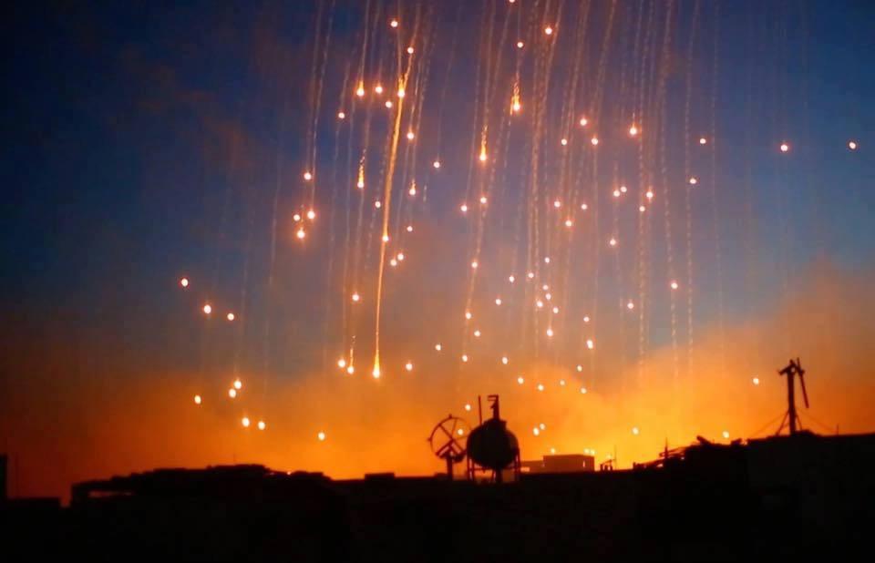 صورة منظمة تدين استخدام التحالف للفوسفور بالرقة