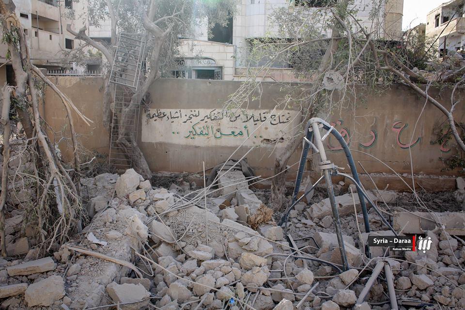صورة مجزرة للأسد بحق نازحي بدرعا