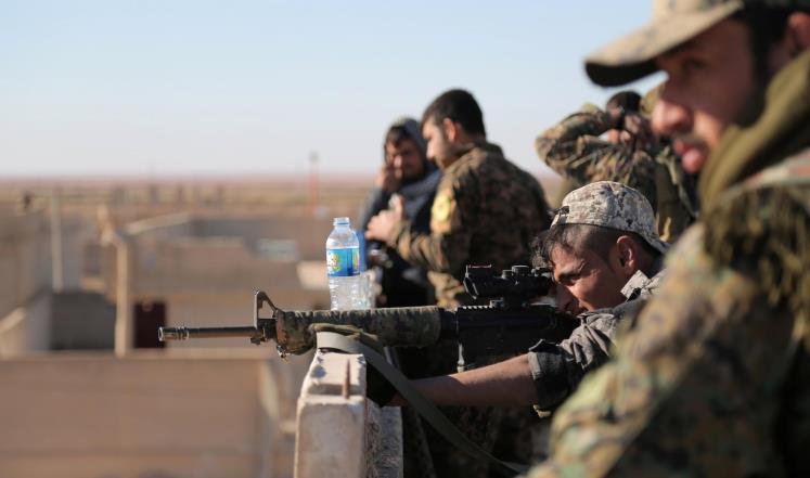 صورة الأسد وقسد يتبادلان الخلافات بالرصاص