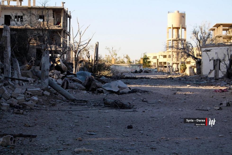 صورة هجرة قسرية لعشرات العائلات في درعا