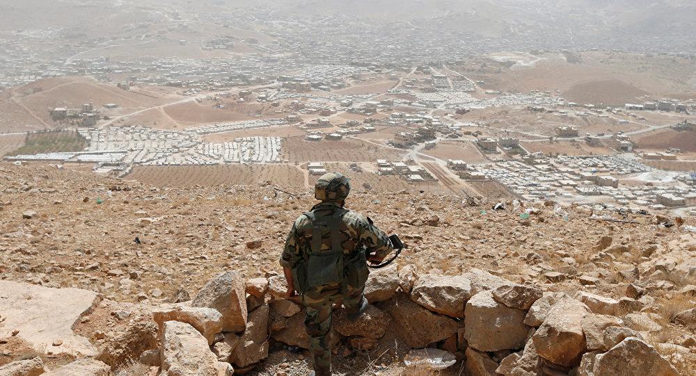 صورة استمرار معارك عرسال ومقتل وسيط لبناني