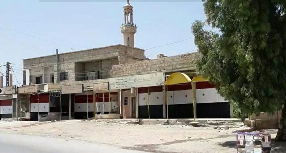 صورة طلاء المحال التجارية بأعلام الأسد أو الاعتقال