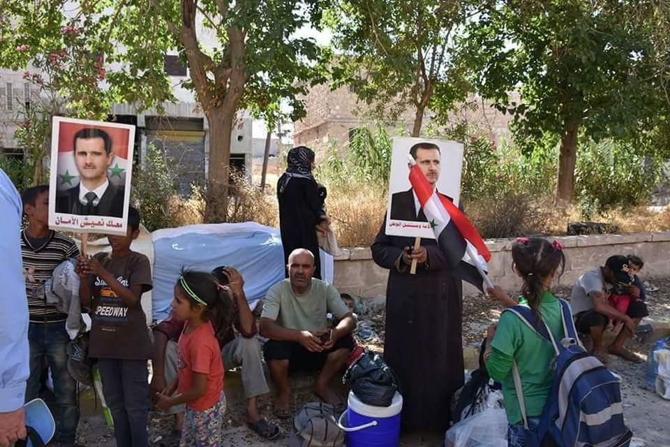 صورة المئات من مهجري الوعر يعودن إلى حمص