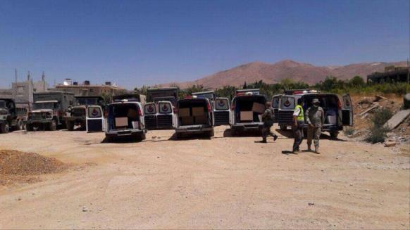 صورة استعدادات لإجلاء آلاف السوريين من عرسال