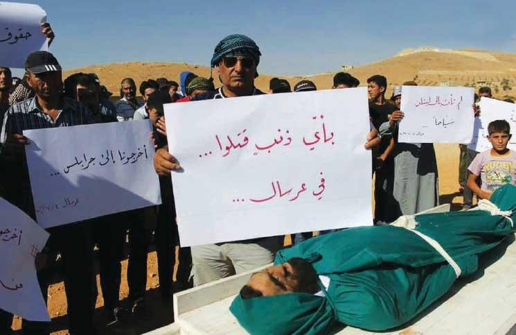 صورة وزير لبناني يطالب بفتح تحقيق بوفاة السوريين تعذيبا