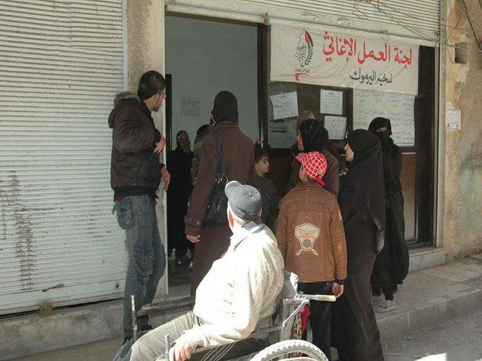 صورة انفجار عبوة ناسفة بالقرب من مكتب اغاثي بمخيم اليرموك