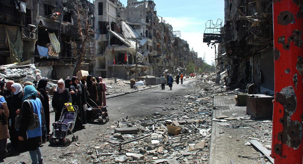 صورة نزوح كبير للمدنيين من مخيم اليرموك