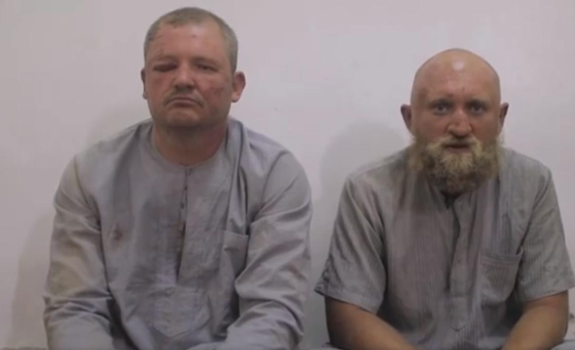صورة تنظيم الدولة ينشر فيديو لمقاتلين روس أسرى وموسكو تنفي