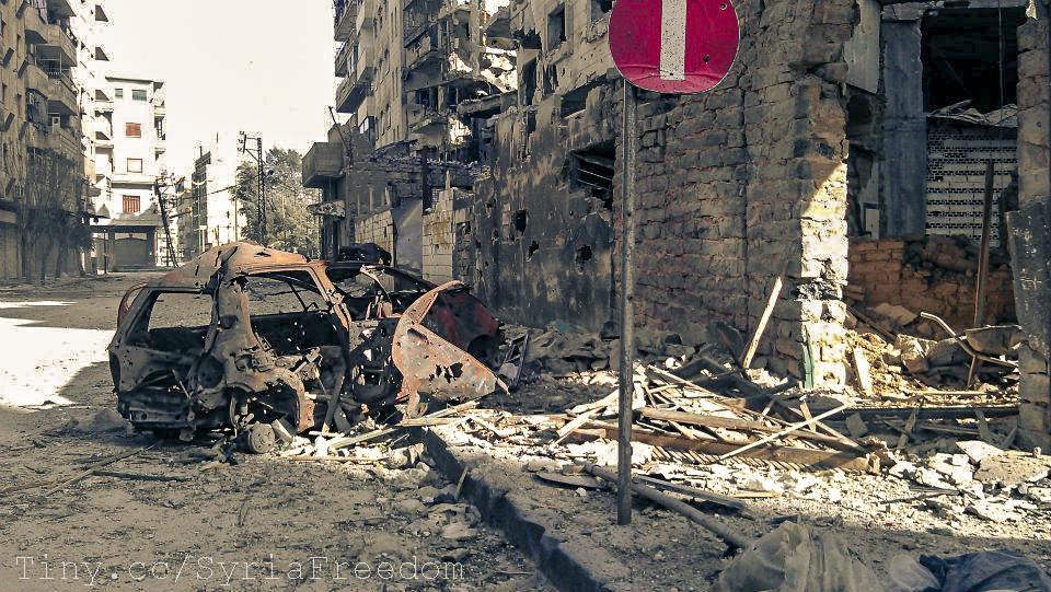 صورة الأسد يدعو إيران لإعادة إعمار سوريا..وروحاني يرحب