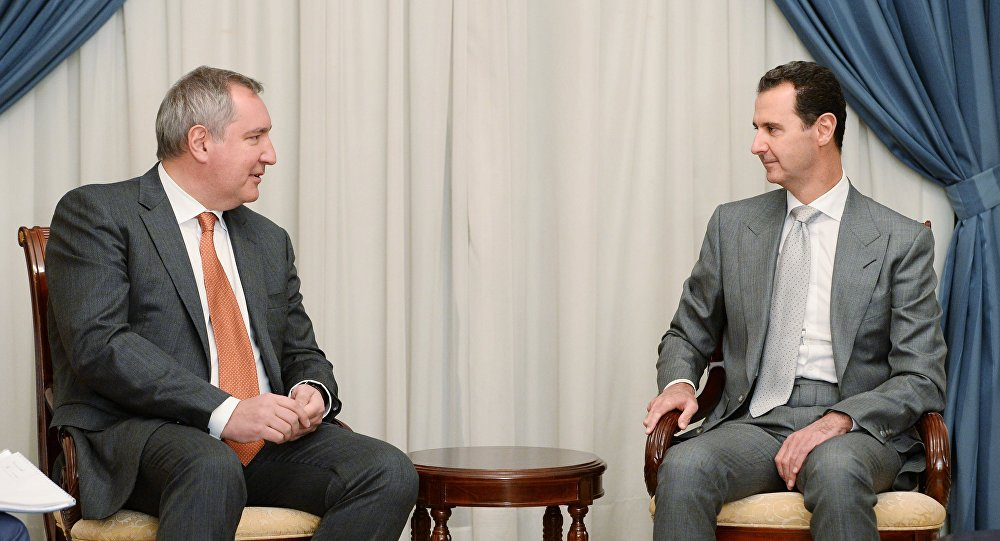 صورة وفد روسي يزور الأسد لقبض ثمن حمايته