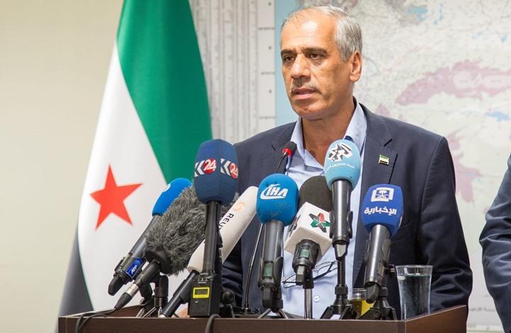 """صورة الحكومة المؤقتة تطالب """"الحر"""" بحماية مواقعها في إدلب"""