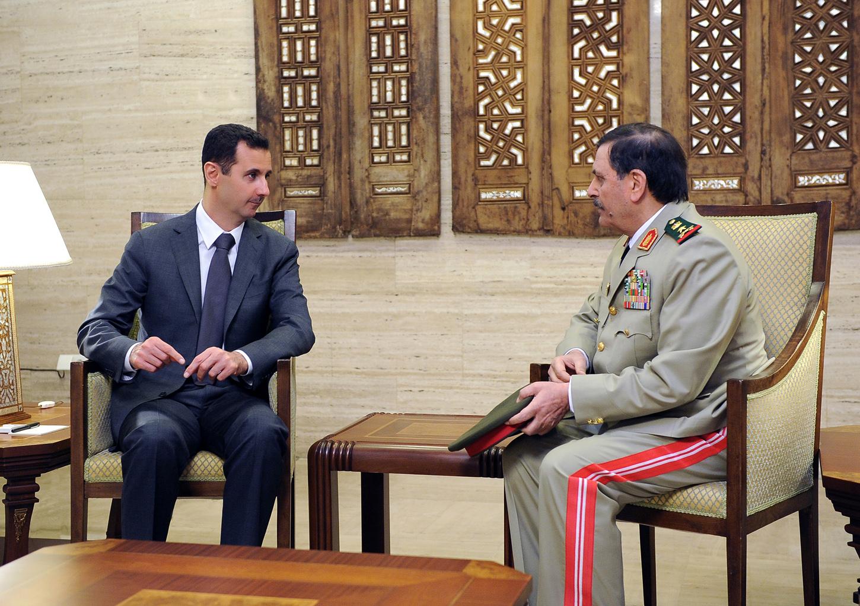 صورة حميميم ترحب بإطاحة الأسد لوزير دفاعه