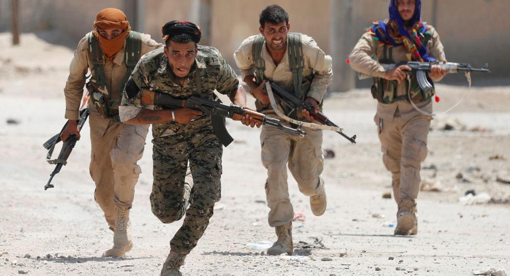 """صورة الإدارة الذاتية تدعو الأسد لـ""""القيام بواجبه السيادي"""""""