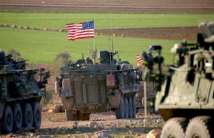 صورة نظام الأسد يهاجم التواجد الأمريكي بسوريا