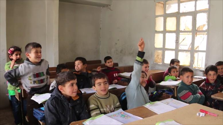 صورة مبادرة تعليمية تخترق أسوار الحصار بحمص