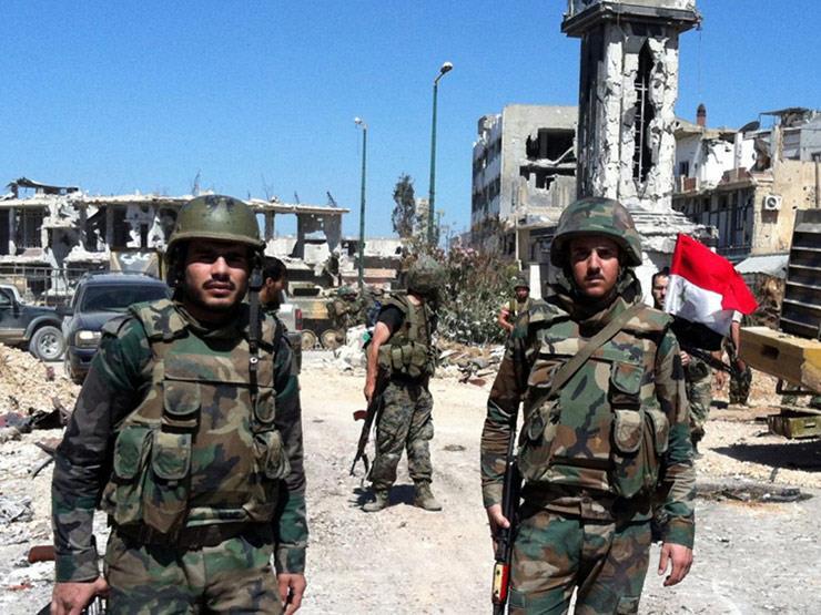 صورة التايمز تسأل: هل أرسل الأسد ثوار الغوطة لمساندة قواته؟