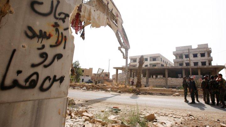 صورة مرسوم للأسد يسلخ المهجرين أملاكهم