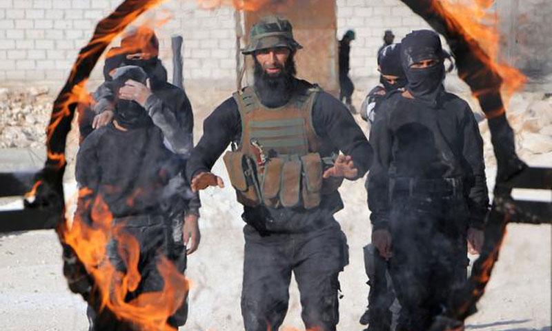 صورة اندماج تنظيمين جهاديين في إدلب