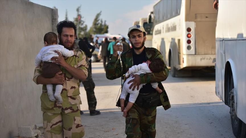 صورة مقتل طفل بهجوم لشبيحة الأسد على قافلة لمهجري دوما