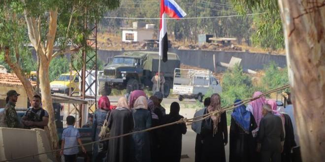 """صورة آلاف الرافضين للخروج من شمال حمص يوقعون """"تسويات"""" مع النظام"""