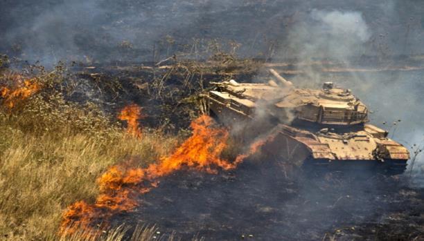 صورة الأسد يحرق محاصيل زراعية بحماة بقيمة 800 ألف دولار