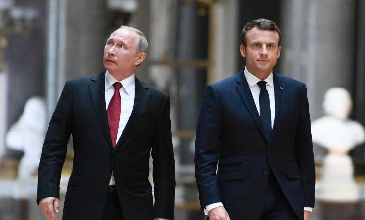 صورة ماكرون وبوتين يبحثان عن حل سياسي لسوريا