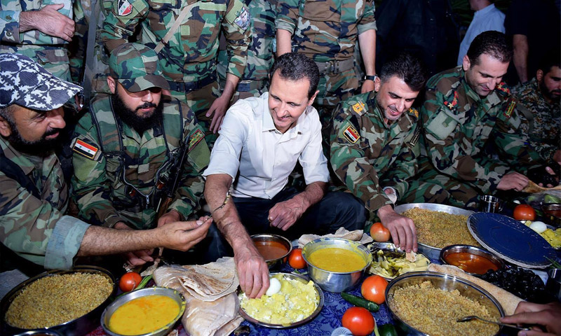 صورة الأسد يغدق 202 مليون ليرة على أسر قتلى الشبيحة