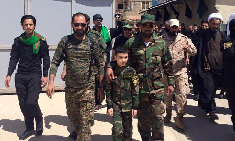صورة عناصر شيعة يتوعدون بإحراق دمشق وأهلها