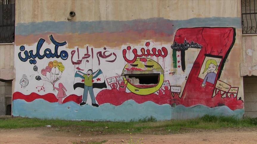 صورة بالجرافيتي..توثيق معاناة السوريين على الجدران المدمّرة