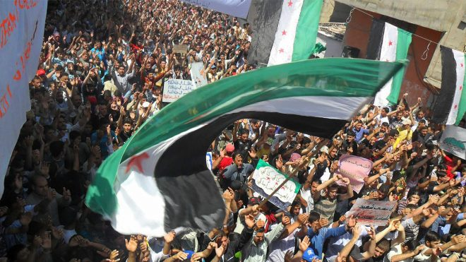 صورة قيادي يدعو درعا لإشعال الثورة مجدداً