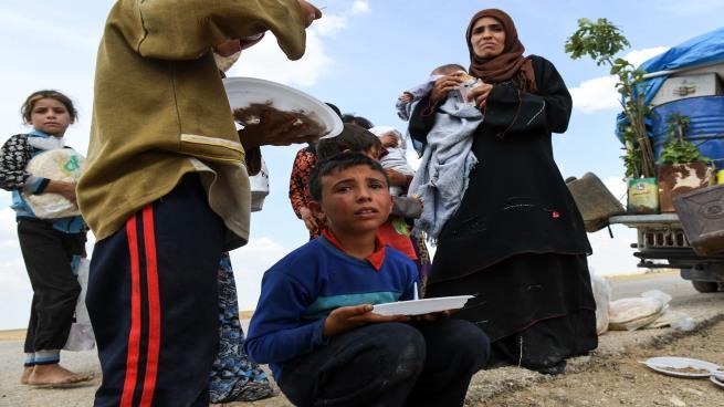 صورة مساعٍ لتفادي كارثة إدلب: أرقام قياسية للنازحين