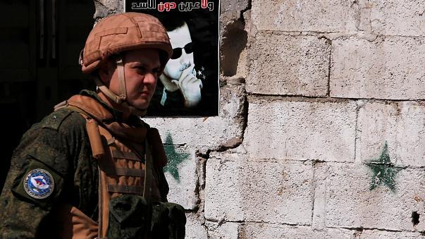 صورة بوتين: لا نخطط لسحب قواتنا من سوريا