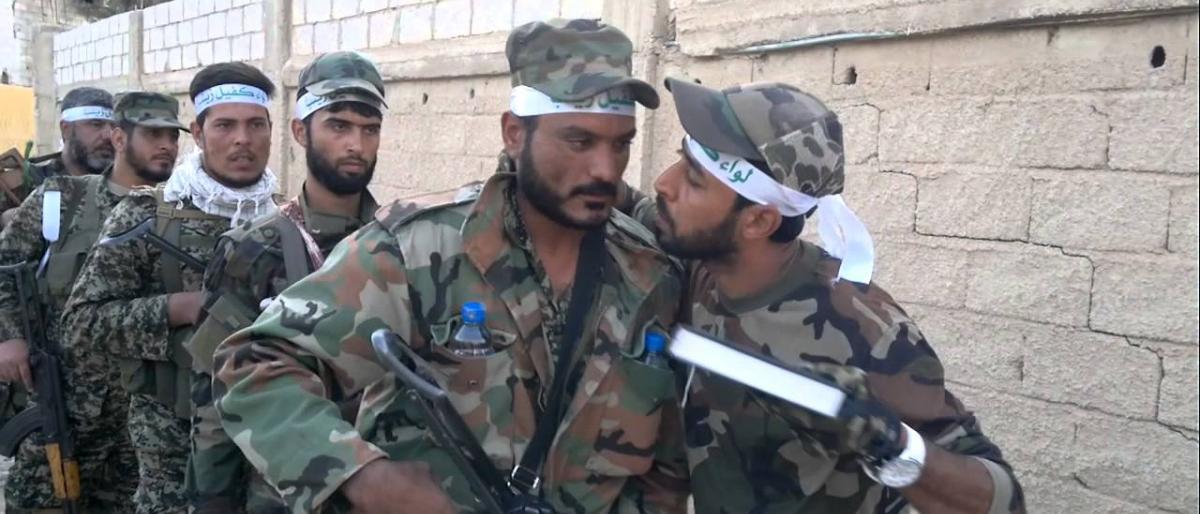 صورة هكذا تُجنِّد إيران فقراء الشيعة الأفغان للدفاع عن الأسد