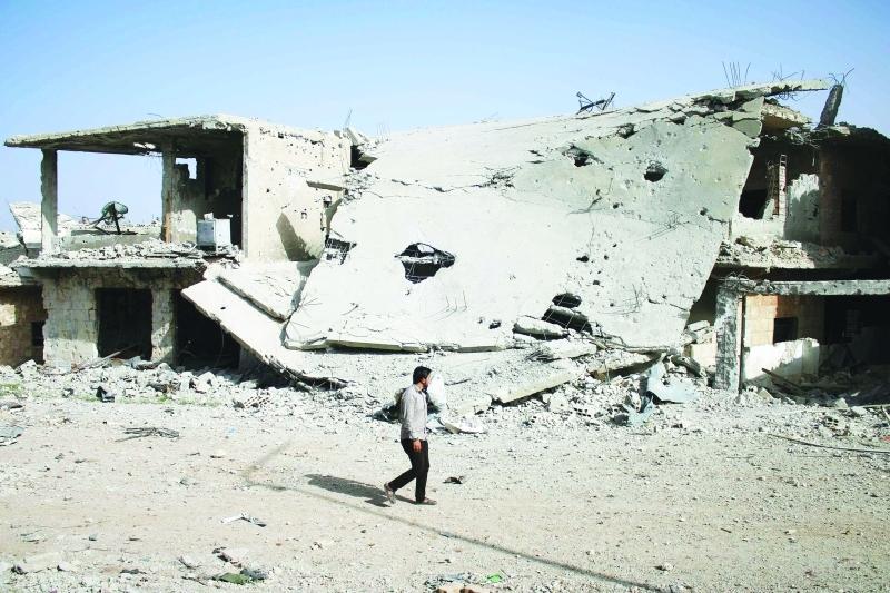 صورة الرقة..30 مدنياً دفنوا تحت ركام منزلهم
