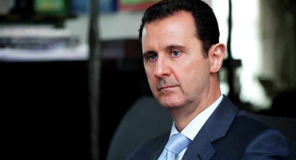 صورة ماكرون: بقاء الأسد في السلطة خطأ فادح