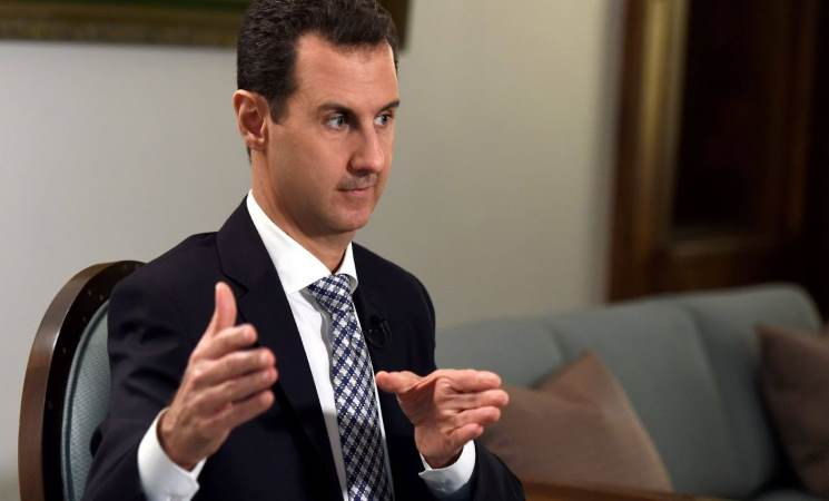 """صورة ذا اتلانتك: الأسد على خطى أبيه """"لا ينبغي للشعب أن يتخيل العالم دونه"""""""