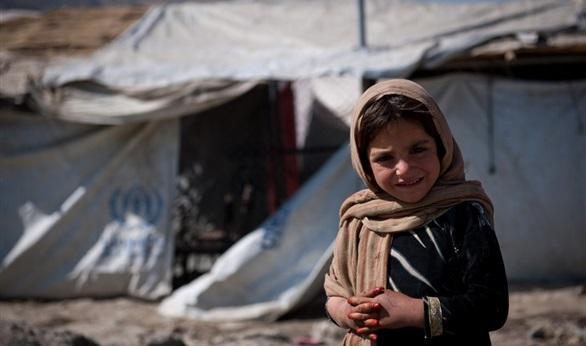 صورة الأسد يرفض عودة مئات العائلات السنية من لبنان