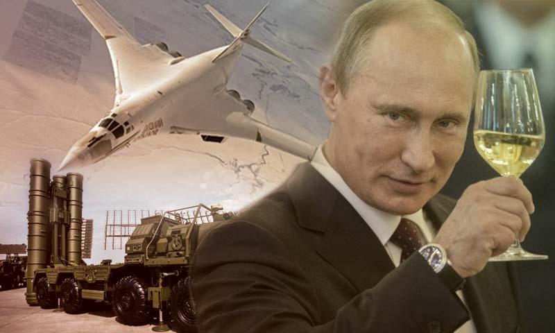 صورة بوتين.. بائع الأسلحة الروسية المتجول