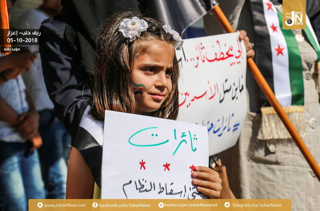 صورة الأسد يتوعد إدلب..ويمتدح سوتشي