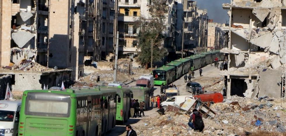 صورة الأسد يصادر أملاك السوريين لتثبيت التغيير الديمغرافي