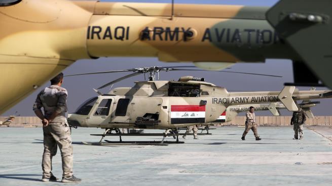 """صورة العراق يحصل على تفويض من الأسد لقصف """"داعش"""""""